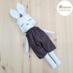 Rabbit doll with dark pants